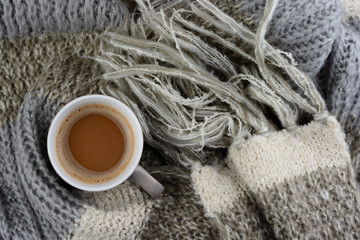 hot chocolate with knitted scarf in the winter