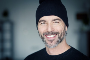 Close Up Of A Mature Man Wearing A Toque Smiling At The Camera