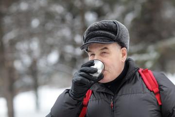 Senior man has tea