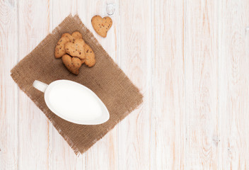Jug of milk and heart shaped cookies