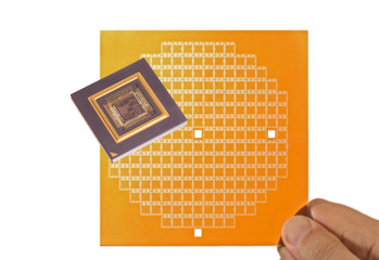 Microprocessor and chip mask in hand isolated on white