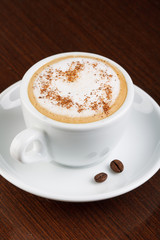 Cappuccino or latte coffee with heart