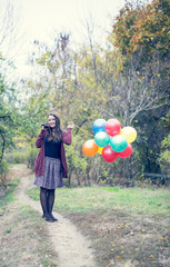 Beautiful girl with her balloons and guitar