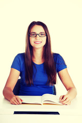 Young woman student with book.
