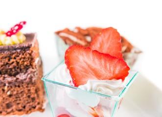 delicious strawberry cake with cream on white