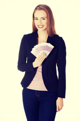 Business woman holdng euro currency money.