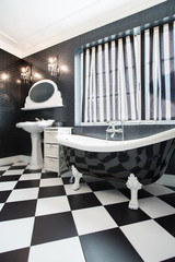 Black bathtub in contemporary bathroom
