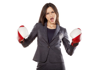 Portrait of angry business woman with boxing gloves