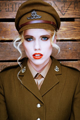 Attractive blond model in army uniform