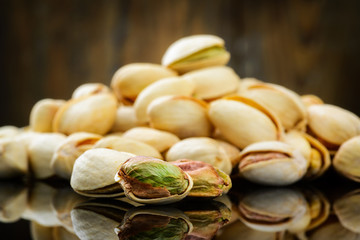 Pistachios on wooden table. Selective focus
