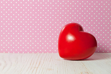 red heart on a background with polka dots