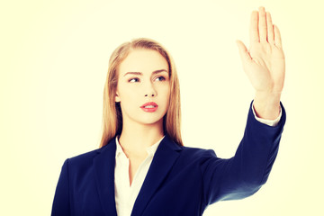 Beautiful business woman showing stop gesture.