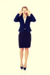 Business woman covering her eyes.