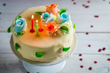 Birthday cake with candles and roses