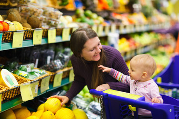 Mother and baby daughter in supermarket