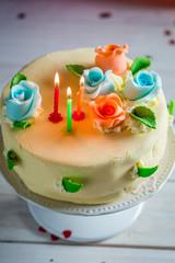 Three candles on birthday cake