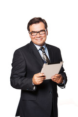 Portrait of a smiling mature business man using tablet. Isolated