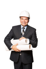 Male mature architect holding a set of building plans, isolated