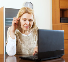 serious mature woman  with laptop