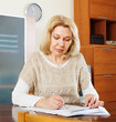 serious mature woman reading  documents