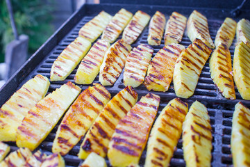 Fried pineapples on grill outdoor
