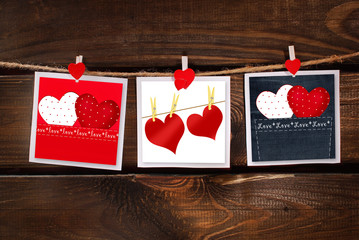 valentines cards hanging on wooden background