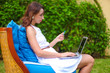 Young woman with laptop during summer vacation