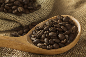 Coffee beans on burlap sack and spoon