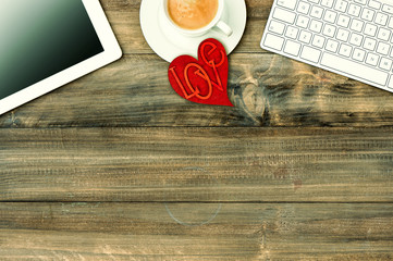 Red love heart, tablet pc, coffee. Valentines Day workplace