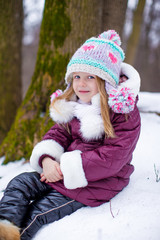 Adorable little happy girl have fun during winter vacation