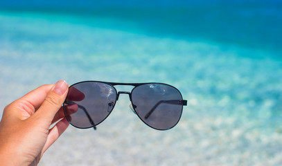 Close up of sunglasses on tropical beach