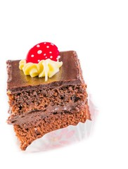 slice of chocolate cake with cream and sugar candy on top