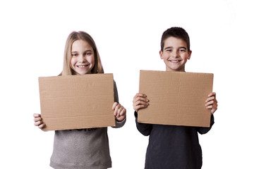 children with cardboard signs