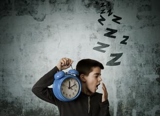 child waking up with alarm clock