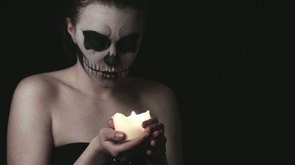 young woman with skull make-up