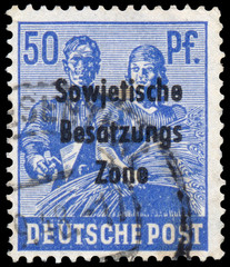 Stamp printed in Germany shows Reaping Wheat