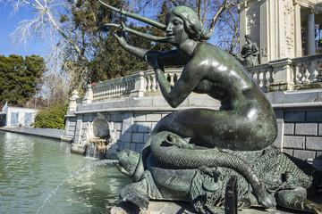 bronze sculpture of a mermaid. Lake in Retiro park, Madrid Spain