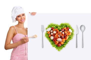 concept vegetarian diet chef woman pointing billboard salad hear