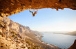 Male climber has just fell of a cliff while rock climbing