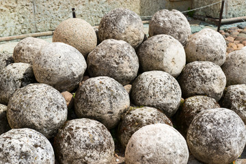 Stone cannonballs in the Kremlin in Novgorod the Great