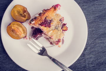 Top view of home baked plum pie served on a plate for dessert