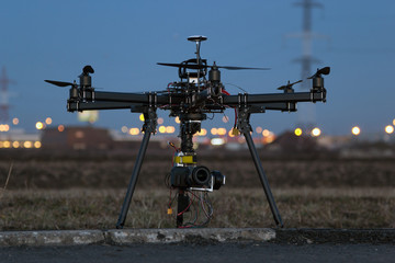 Professional drone prepares for flight in the evening