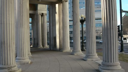 Pan across the roman columns at the Denver Civic Center park