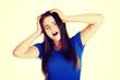 Young woman having terrible headache.
