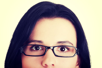 Female's face with eyeglasses.