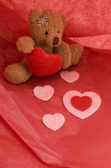 Valentine's Day Teddy Bear and Hearts with Red Paper