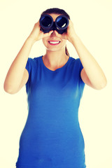 Beautiful young woman with binoculars.
