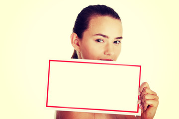 Young casual woman holding copy space.