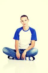 Beautiful young teenage woman sitting.