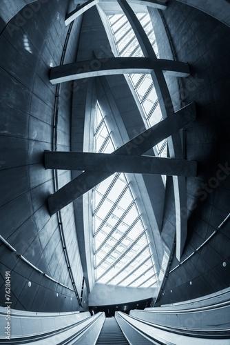 Leinwanddruck Bild Moving escalator in the business center